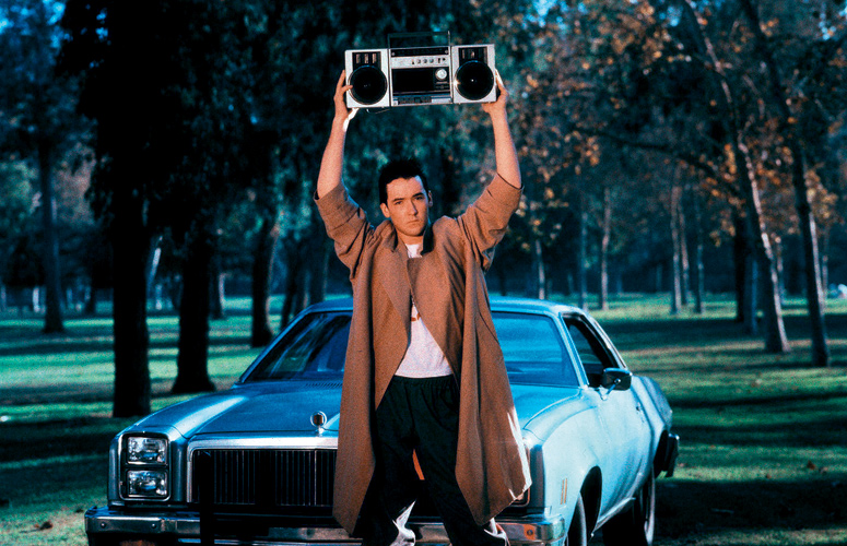 John Cusack lifting weights. Oh, there's music playing too.