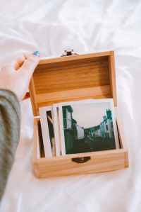 close up photo of pictures on wooden box
